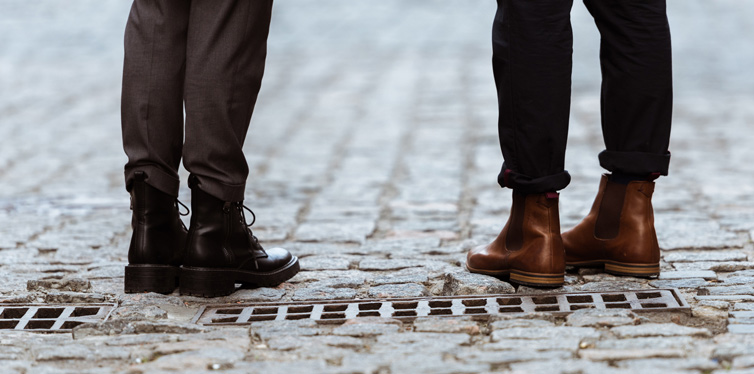 a couple wearing leather shoes