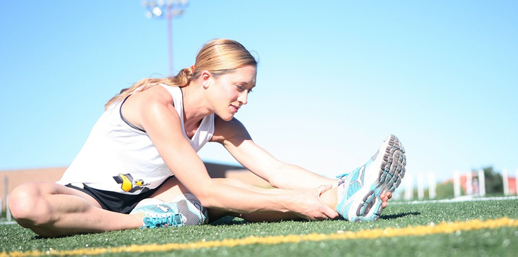 a runner stretching