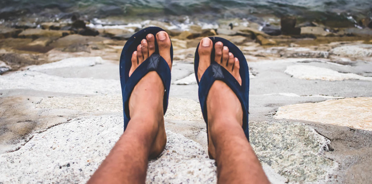 man wearing flip flops