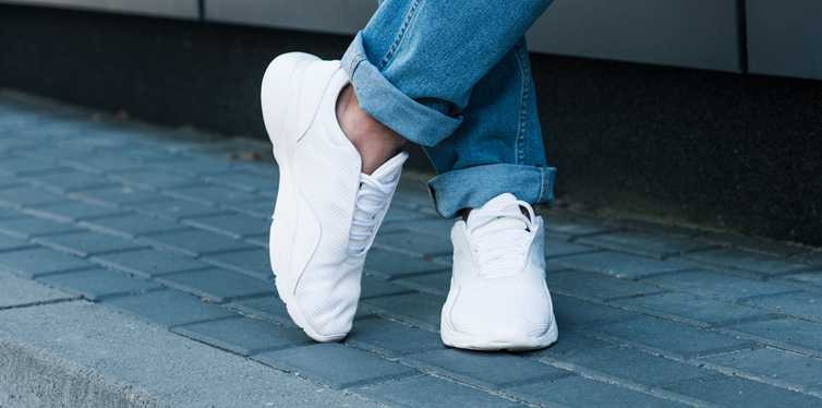 wearing white sneakers