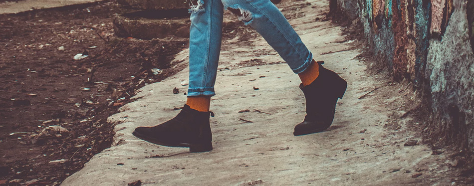 young man wearing chelsea boots