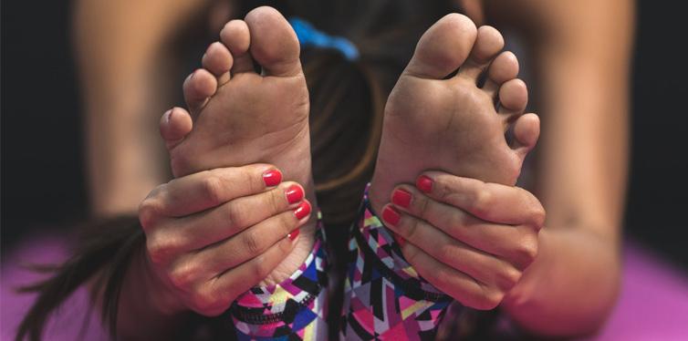 girl holding her feet
