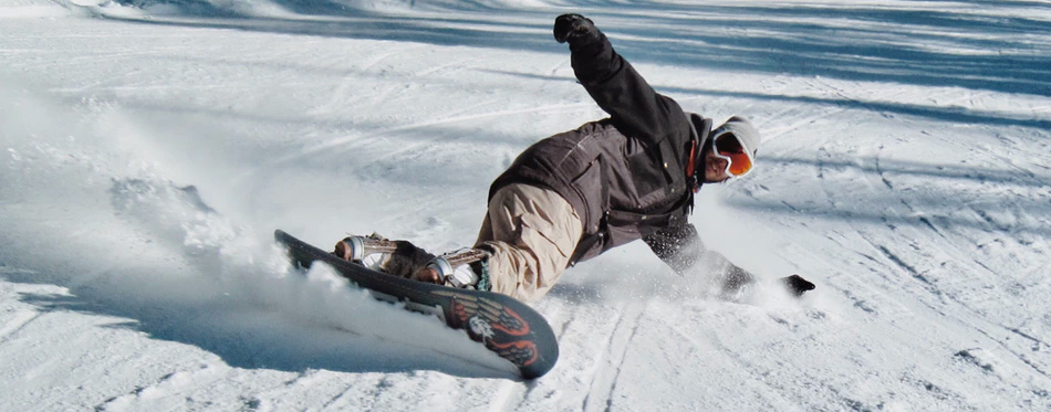 a snowboarder wearing snowboard boots