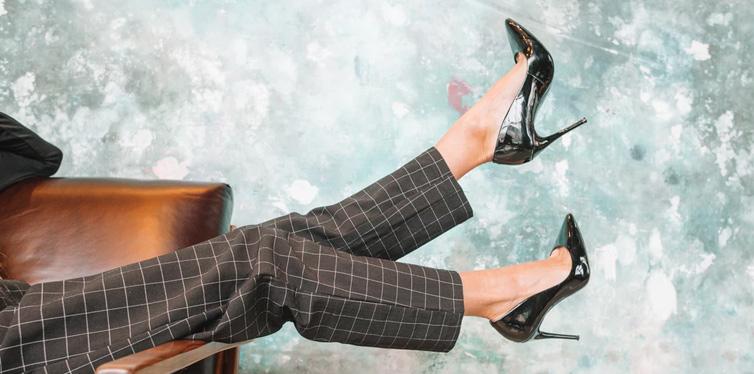 woman in black hight heel shoes