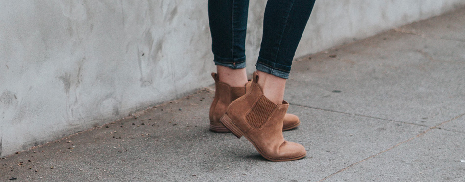 woman wearing brown suede ankle boots
