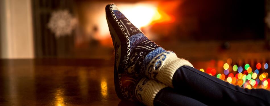 woman wearing warm house shoes