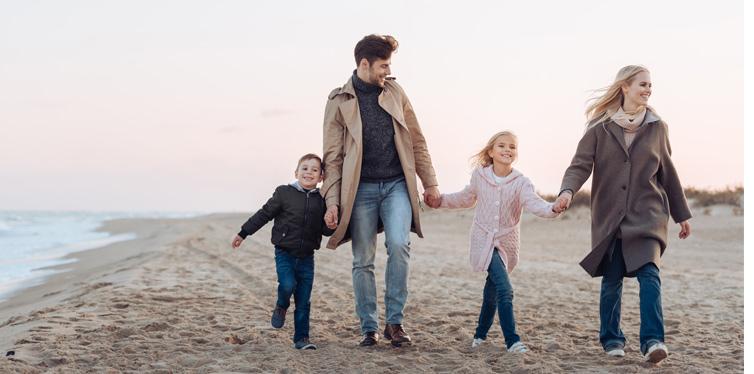 a family taking a walk at the beach