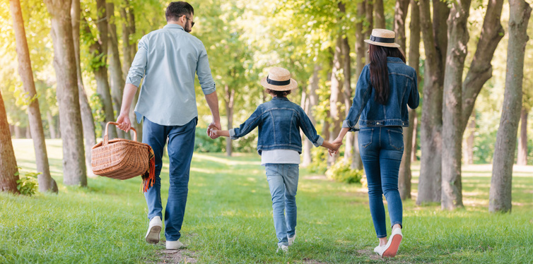 a family taking a walk in the park