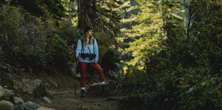 a girl hiking in the woods