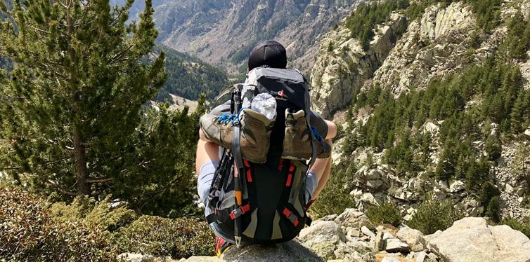 a hiker sitting on a rock