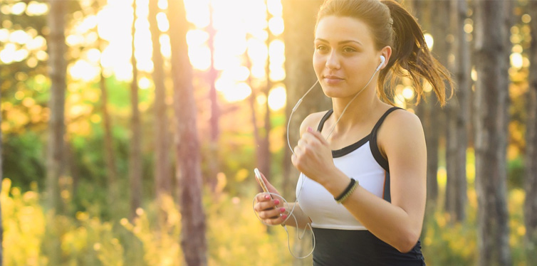 girl running with headphones