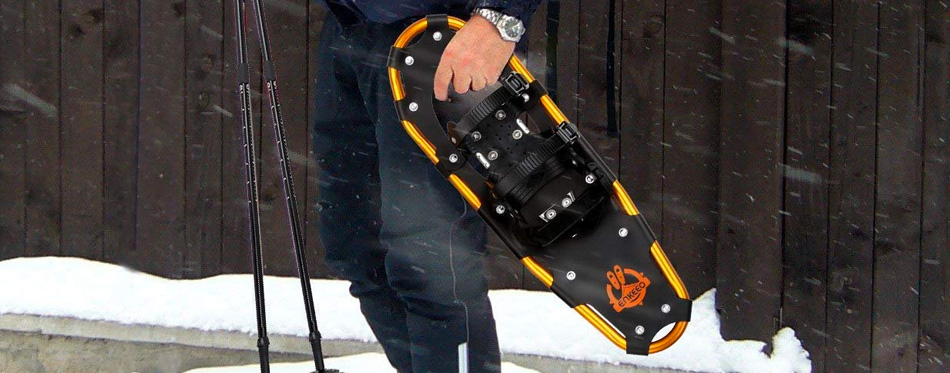 man holding a snow shoe