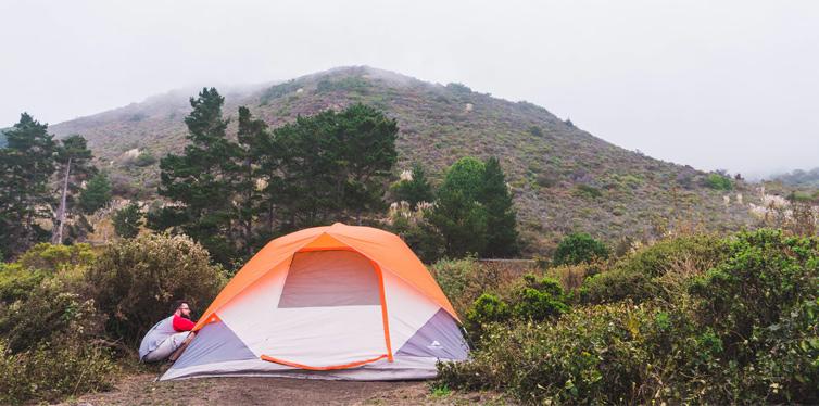 man putting up a tent