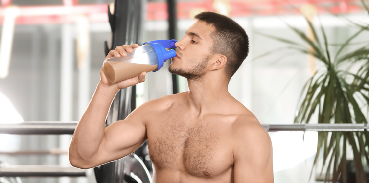 man with protein shake