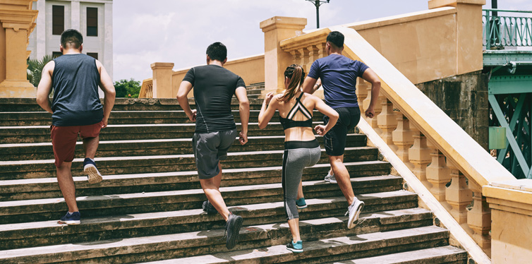 runners training up the stairs