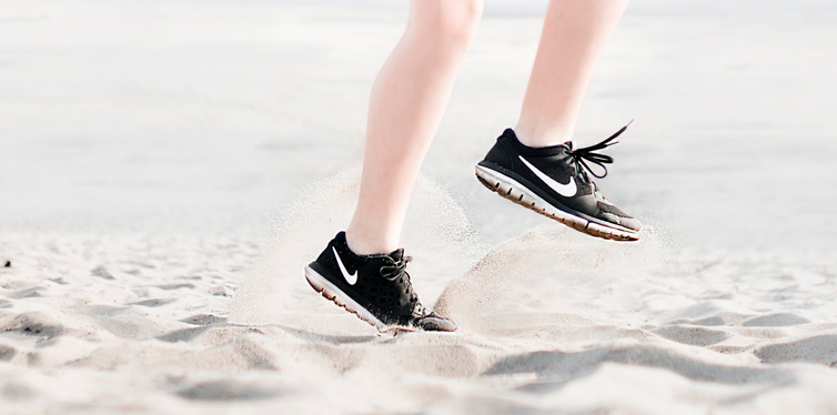 running shoes on sand