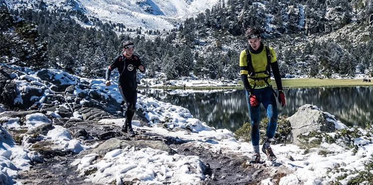 two runners on snow