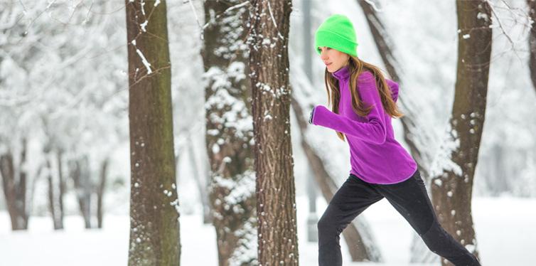 woman running on snow