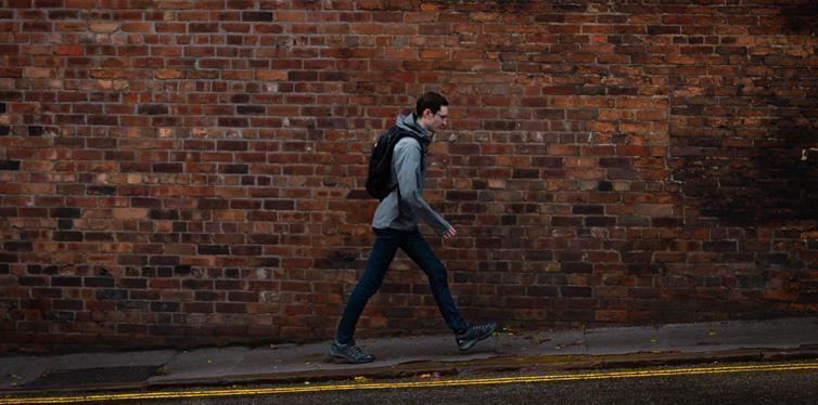 man walking up hill