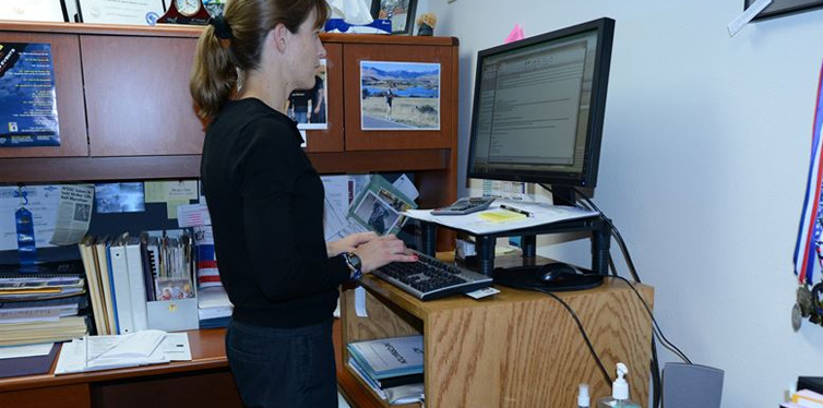 woman using a standing desk