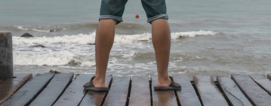 man standing in slides