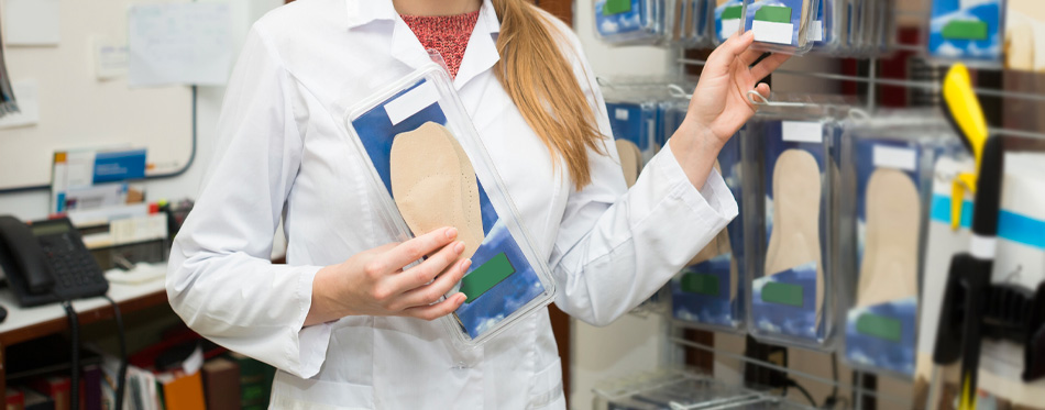 orthopedist holding insoles
