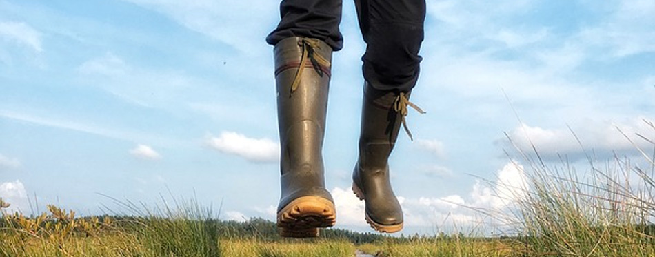 walking in muck boots
