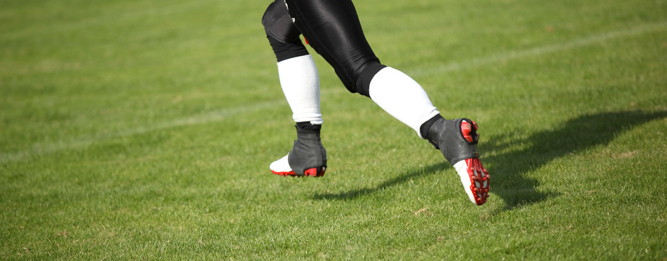 american football player wearing pro cleats