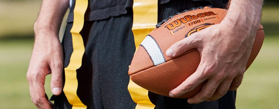 holding football
