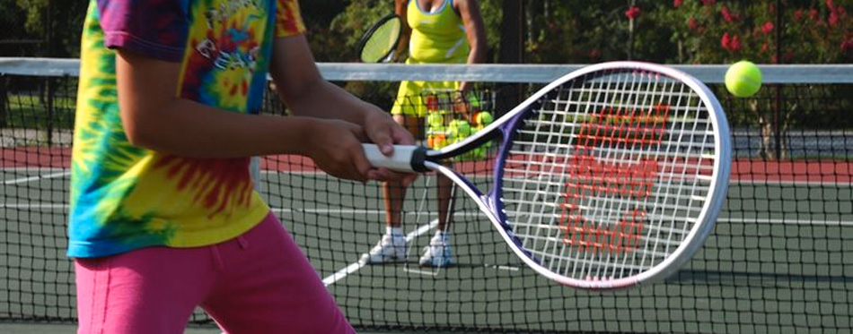 holding tennis racket