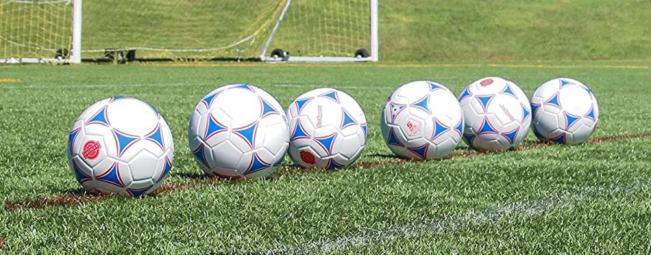 soccer balls in line