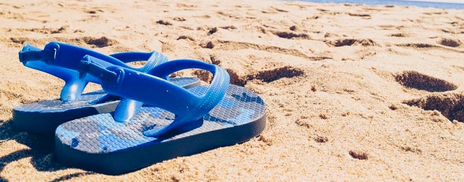 men sandals on the beach
