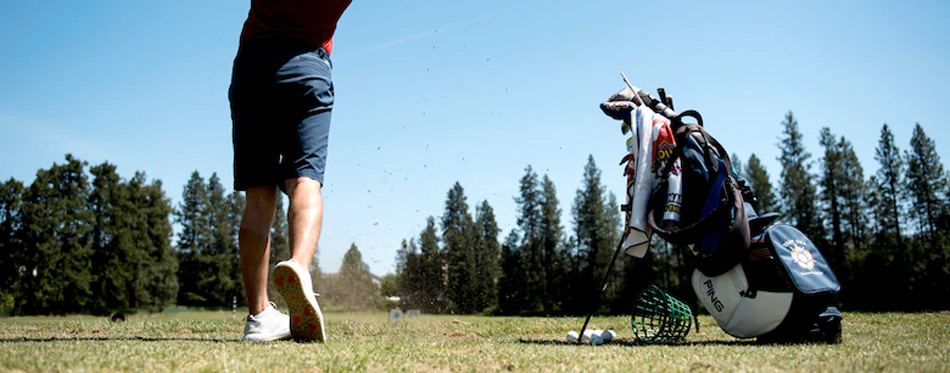 player with golf bag