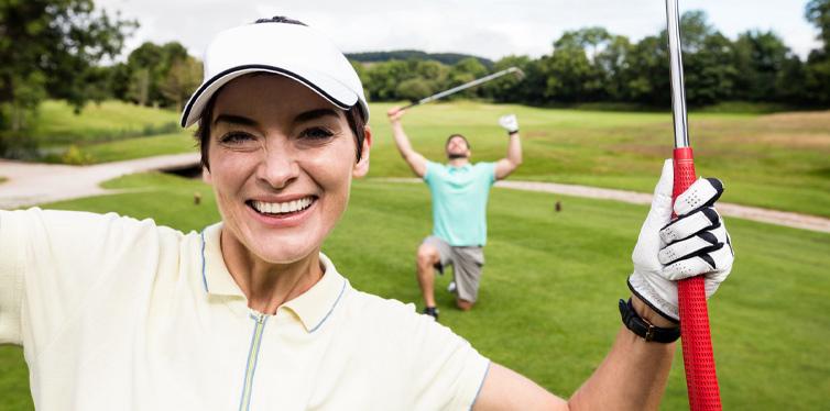 wearing golf gloves